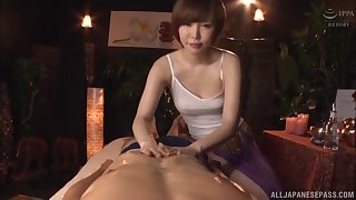 Short haired Japanese Satomi Yuria massages a load of shit with her pussy