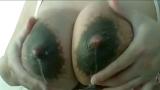 This slut loves to milk her own lactating breasts and her tits drives me inane